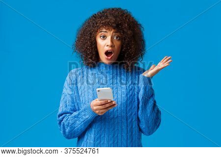 Concerned And Worried Shocked Young African-american Woman Receive Unpleasant News Via Smartphone, T