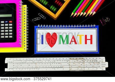 I Love Math-the Text Is Written In Colored Letters In A Student's Notebook. Mathematical Calculation