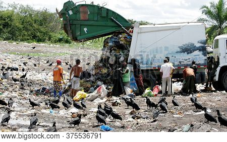 Eunapolis, Bahia / Brazil - March 29, 2011: People Are Seen Collecting Material For Recycling At The