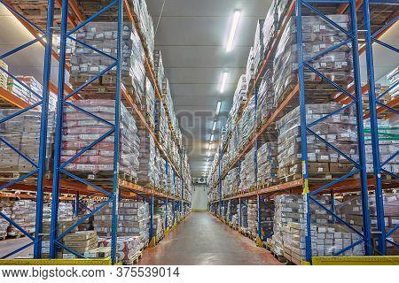 St. Petersburg, Russia - October 10, 2016: Storage Warehousing With Pallets, Metal Shelving. Perisha