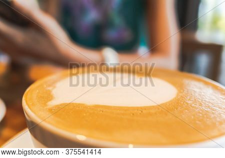 mocha coffee with latte art on a table in the coffee shop