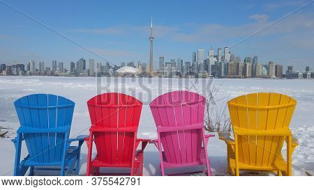 View Of Toronto City Skyline Seen Form Toronto Islands With Colourful Chairs