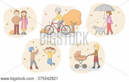 Autumn Concept. People In Warm Clothes Walking In The Park, Riding Bicycle, Walking With Dog And Wit