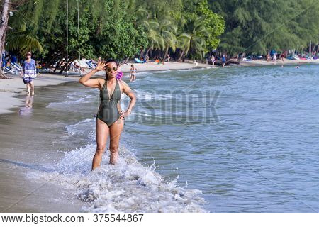Woman Body Big With Swimsuit On Beach Koh Chang Thailand. Koh Chang Is Located In The Eastern Gulf O