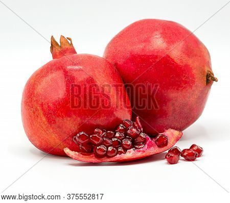 Pomegranate Isolated On White Background,pomegranate Leaves And Sliced