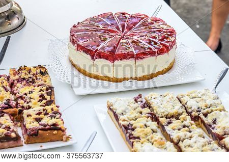 Table Full With Beautiful And Delicious Cakes At Wedding Reception Buffet