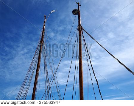 Sailing Masts Of Traditional Vintage Wooden Tallships Sky Background