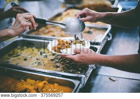 Food Donated To Hungry People Homeless : Concept Of Giving
