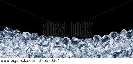Ice cubes isolated on a black background. File contains clipping path. Panoramic image.