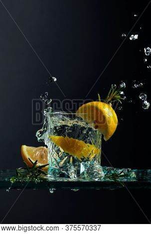 Cocktail Gin-tonic With Lemon And Rosemary.  Black Background, Copy Space.
