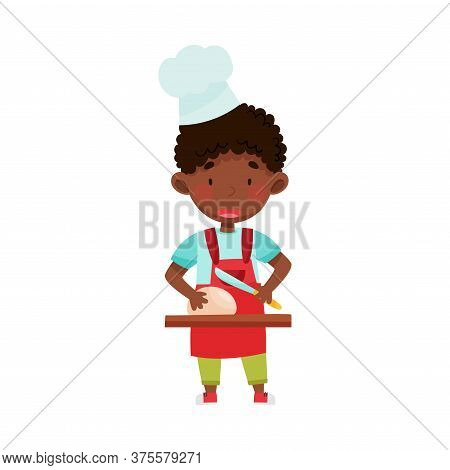 Little African American Boy Character In Hat And Apron Standing At Kitchen Table And Molding Dough V