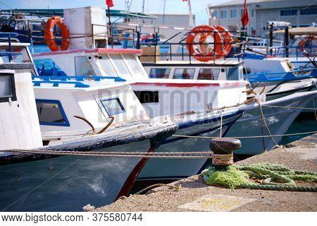 Mooring Bollard And Moored Boats At Marina