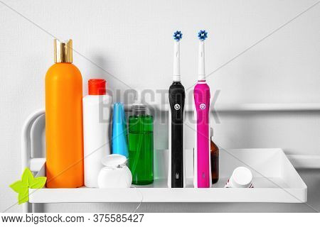 There Are Dental Floss In Box, Toothpaste, Two Electric Toothbrushes, Tubes With Various Hygiene Pro