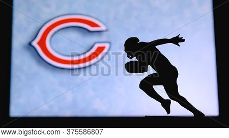 Chicago Bears. Silhouette Of Professional American Football Player. Logo Of Nfl Club In Background,