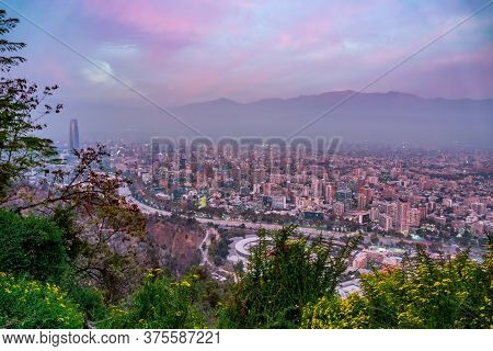 Santiago De Chile Downtown At Dusk With Andes