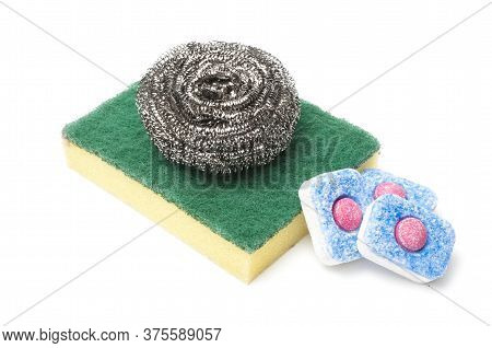 Dish Washing Items On White Background: Three Dishwasher Tabs And A Wool Cleaning Pad Over A Sponge