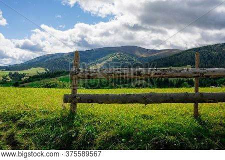 Fence On The Hill In Rural Area. Early Autumn Scenery In Carpathian Mountains. Sunny Weather With Cl