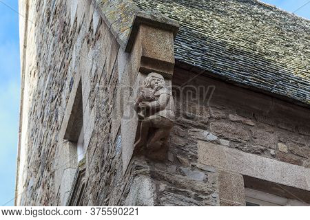 Saint-malo, France - September 3, 2019: This Is A Carved Stone Figure Of The Piper Maker Decorating