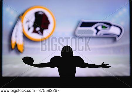 Washington Vs. Seattle Seahawks. Nfl Game. American Football League Match. Silhouette Of Professiona