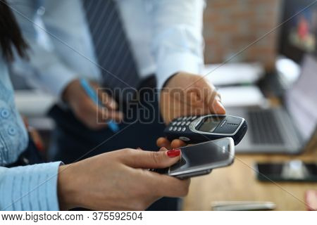 Minsk, Belarus - Jule 8 2020 : Two Business People Hol Button Vintsge Phone Nokia 8800 And 3310 In H