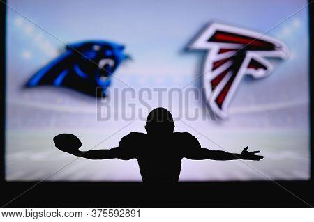 Carolina Panthers Vs. Atlanta Falcons . Nfl Game. American Football League Match. Silhouette Of Prof