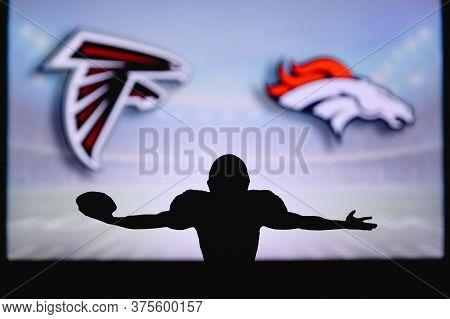 Atlanta Falcons Vs. Denver Broncos. Nfl Game. American Football League Match. Silhouette Of Professi