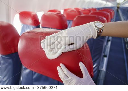 Close Up Hand Is Wearing Gloves Cleaning Aircraft Seat For Covid-19 Prevention Pandemic