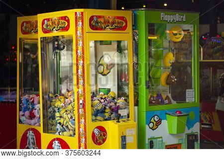 Two Claw Crane Maschines. Classic Claw Grabber Game Machines Filled With Toys. Copenhagen, Denmark -