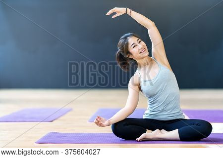 Young Attractive Asian Woman Stretching Yoga At Home With Concept Of Activity In Quarantine Coronavi
