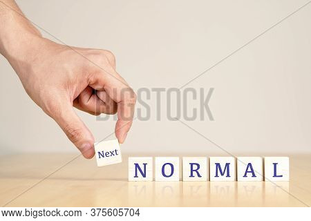 Man's Hand With Concept Of New Or Next Normal Digital Transform In Industry Business, Disrupt From C