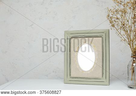 Vintage Blank Frame Mockup With Flowers On White Table