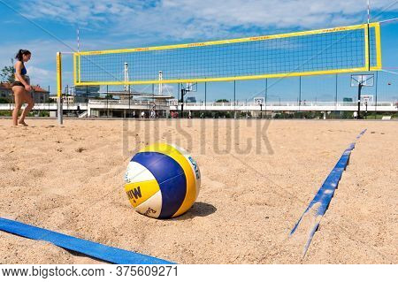 Vilnius, Lithuania - July 3 2020: Beach Volley, Ball On The Sand And Girl And Net On Background