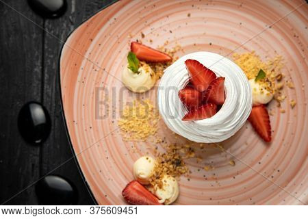Homemade Small Strawberry Pavlova Meringue Cakes With Mascarpone Cream And Fresh Mint Leaves. Dish,