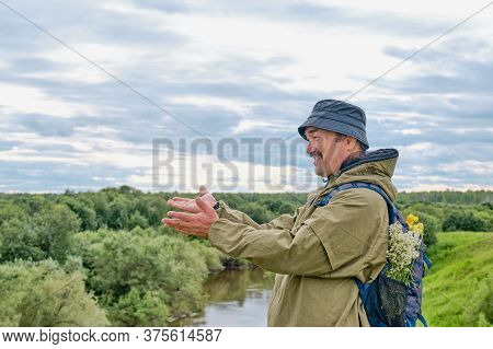 Active Asian Senior Man With Backpack In Hiking Near River In Siberia, Russia. Solo Traveling, Lifes