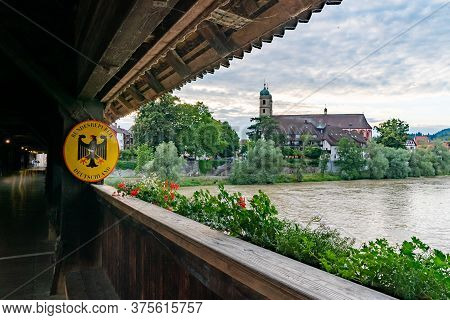 Bad Saeckingen, Bw / Germany - 4 July 2020:  Crossing The Historic Covered Wodden Bridge Into German