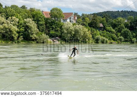 Bad Saeckingen, Bw / Germany - 5 July 2020: Surfer Bungee Surfing On The Rhine River In Bad Saecking