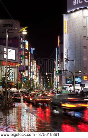 Shinjuku, Tokyo, Kanto Region, Honshu, Japan - April 20, 2010: Nigh View At Nigh Under The Rain Of