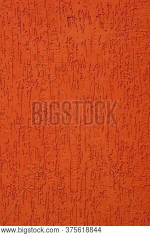 Texture Of An Orange Cement Wall In Flaming Lava Color. Trend Lush Lava.