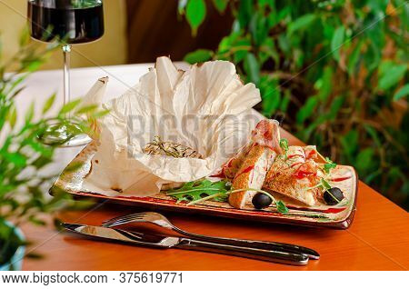 Grilled Camembert Cheese With Baguette, Prosciutto And Glass Of Red Wine. French Delicacy Concept.