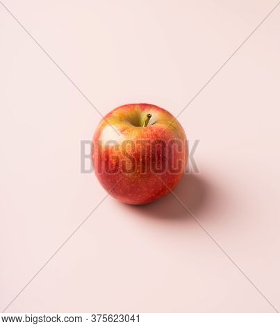 Seasonal Apple Fruit At Pink Solid Background. Minimal Concept Of Harvest Seasonal Raw Fruit