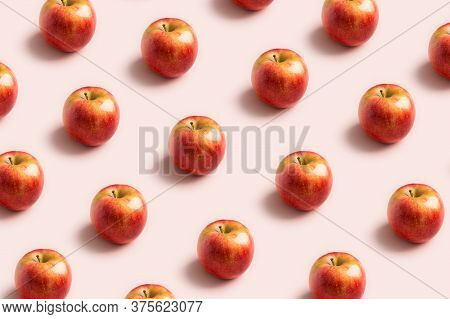Apple Minimal Pattern At Soft Pink Background. Concept Of Harvest Raw Food. Space For Text, Deliciou