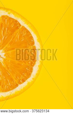 Fresh Tasty Sliced Orange At Yellow Background With Copy Space. Minimal Concept Of Harvest Juicy Swe