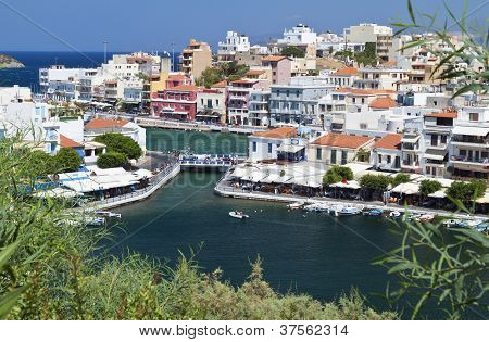 Aghios Nikolaos city at Crete island in Greece. View of the harbor poster