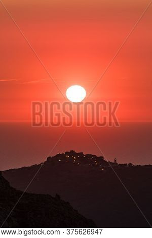 Sun Setting Over The Village Of Sant'antonino And Mediterranean