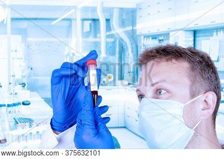 Proctologist, A Doctor In Medical Clothing Holds A Rubber Syringe, An Enema. Detox Medical Concept
