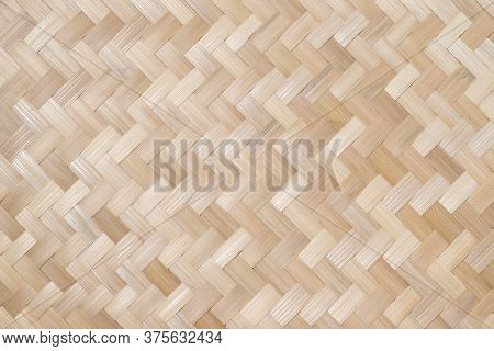 Texture Details Of Bamboo Weave. Vertical Zigzag Pattern Of Thai Wickerwork For Furniture Made From