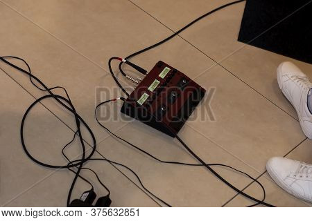 Guitar Pedal Control. On The Floor. Theres A Guitarist Nearby. Weve Had His Legs In Sneakers And Wir