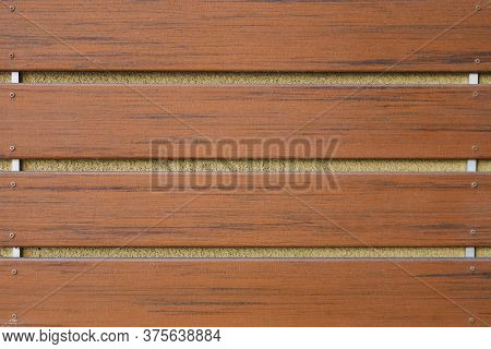 A Stained Wood Slate Panel Wall Concrete Background
