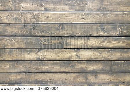An Aged Natural Wood Panel Wall Background Backdrop
