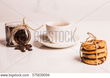 Differential Focus. Biscuits With Chocolate Bandaged With Canvas Rope, Are On White Plastic Backgrou